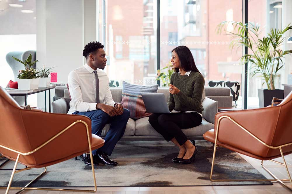 Two people discussing job in an office